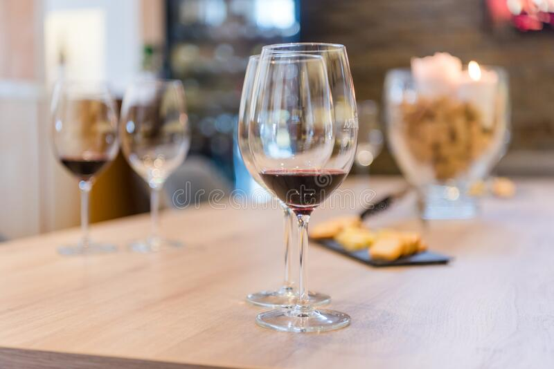 Close up on wine glasses in vineyard shop at tasting experience royalty free stock images