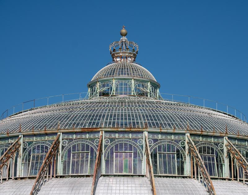 Close up of the Winter Garden with crown on top, part of the Royal Greenhouses at Laeken, Brussels, Belgium. stock photography