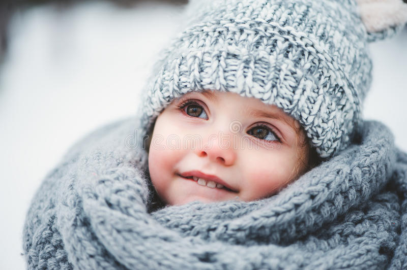 Close up winter portrait of adorable smiling baby girl stock image