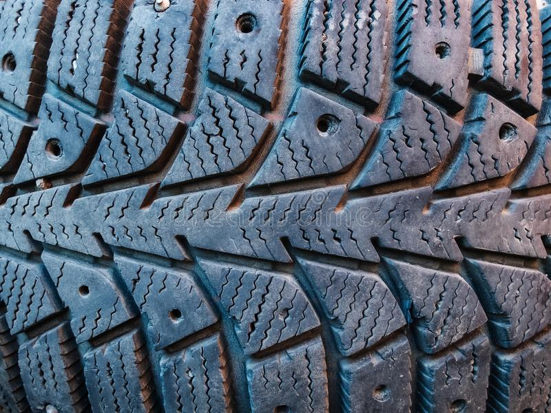 Close-up of winter studded car tyre protector stock photography