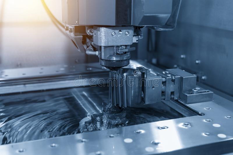 Close-up of the wire - EDM CNC machine while cutting the sample royalty free stock photos