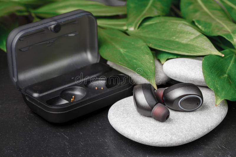 Close up wireless earphones, waterproof for fitnes royalty free stock photography