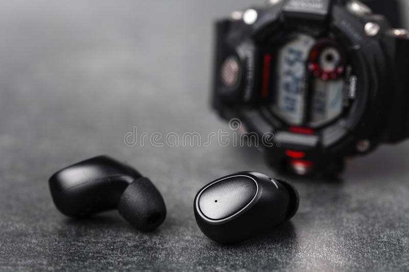 Close up wireless earphones, waterproof for fitnes stock images