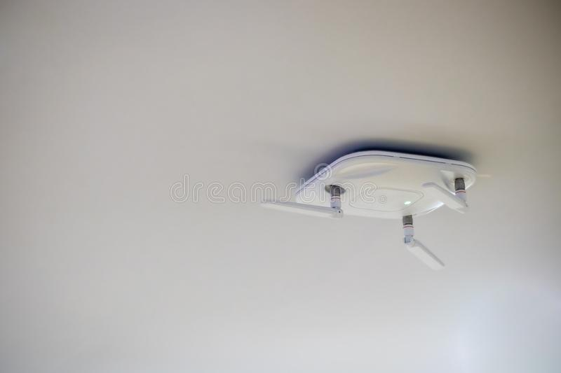 Close up wireless router for network,hang on the ceiling. royalty free stock images