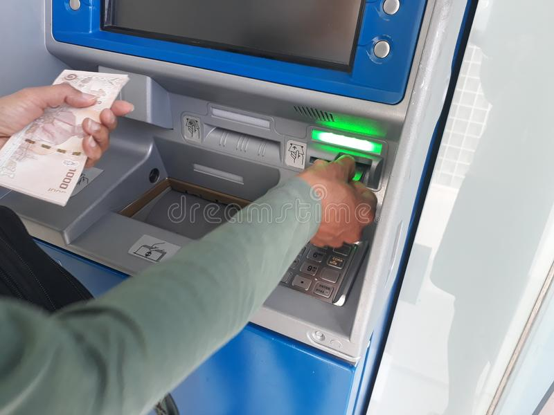 Withdraw money from ATMs stock image