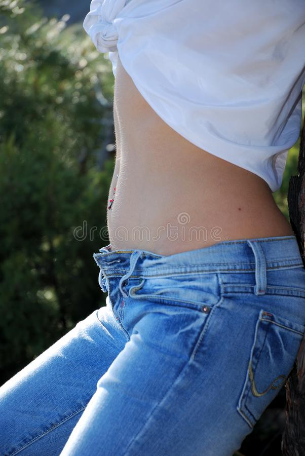Close-up of woman belly royalty free stock photos