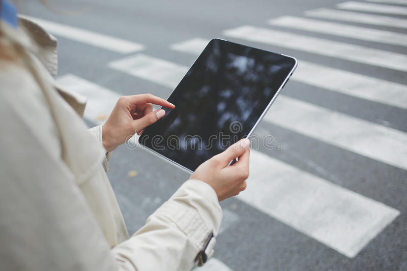 Close up woman is checking e-mail on touch pad with blank copy space screen. Closely of business person is using banking application via digital tablet, while is royalty free stock images