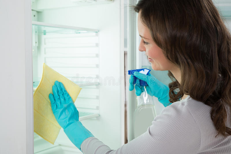 Close-up Of Woman Cleaning Refrigerator royalty free stock image