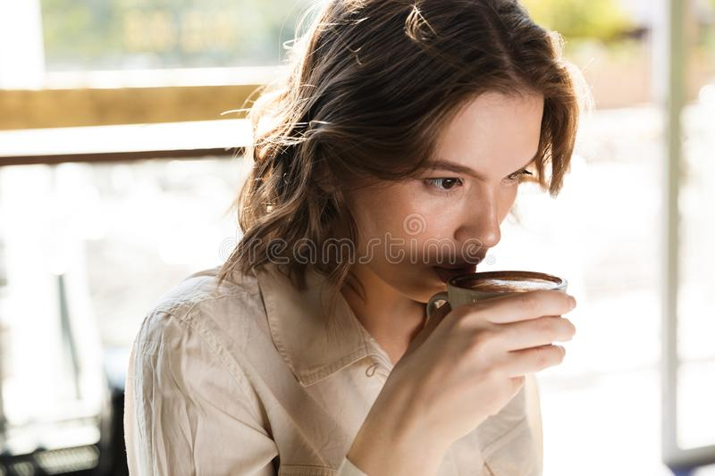 Close up of a woman drinking coffee royalty free stock photos