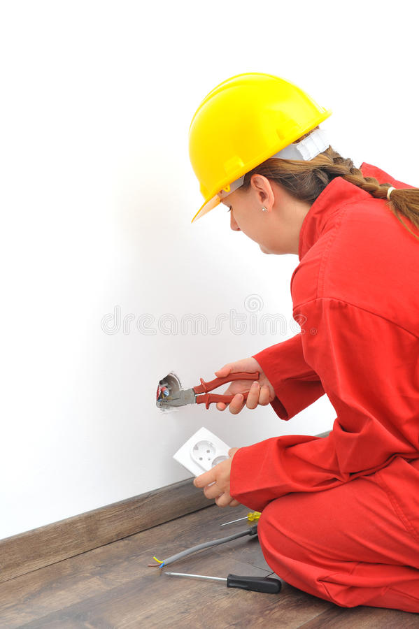 Close up of woman electrician fixing socket stock images