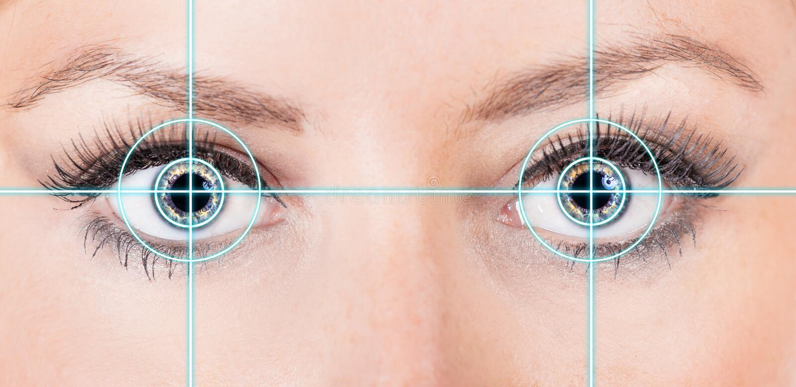 Close-up woman eye with laser medicine. Technology concept royalty free stock photography