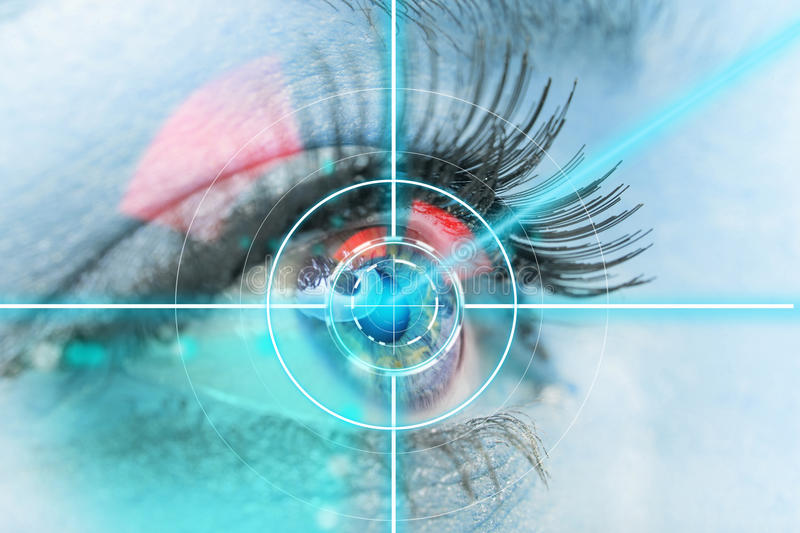 Close-up woman eye with laser medicine. Technology concept stock image