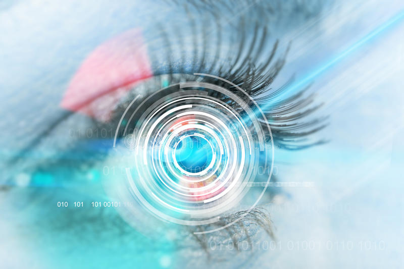 Close-up woman eye with laser medicine. Technology concept royalty free stock photos