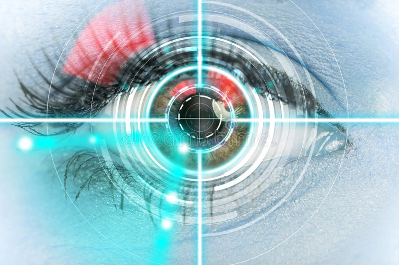 Close-up woman eye with laser medicine. Close-up woman eye with laser medicine, technology concept royalty free stock photography