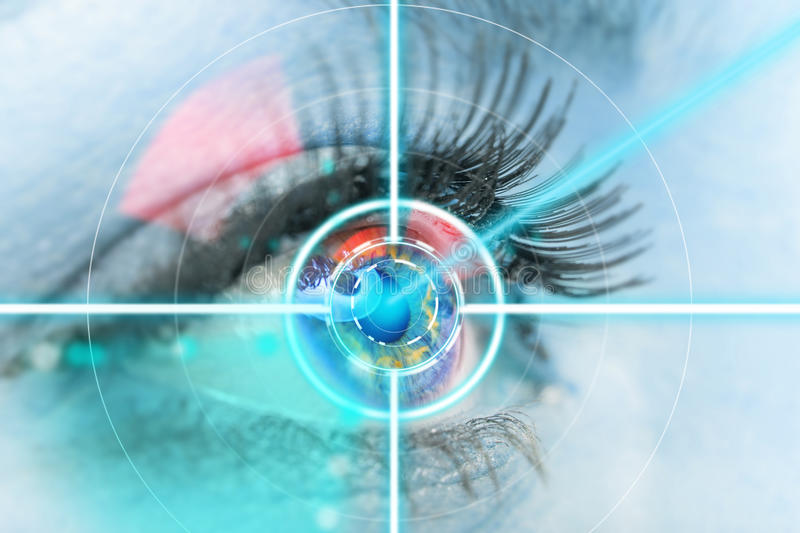 Close-up woman eye with laser medicine. Close-up woman eye with laser medicine, technology concept royalty free stock image