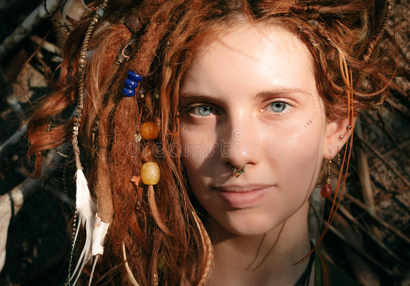 Close up Woman Face with Dreadlocks and Piercing royalty free stock images