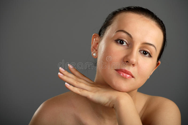 Close-up woman face rests in arm and hand royalty free stock photography
