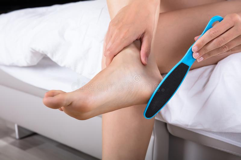Woman Filing Foot stock image