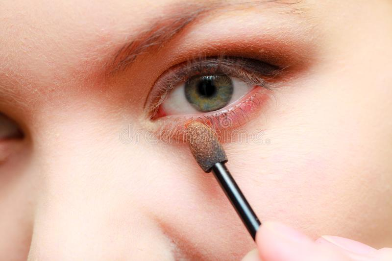 Close up woman getting make up, eyeshadow royalty free stock photos