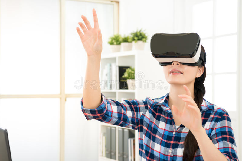 Close up of woman getting using VR-headset. Close up of smile happy woman getting using VR-headset glasses of virtual reality at home and showing much royalty free stock image