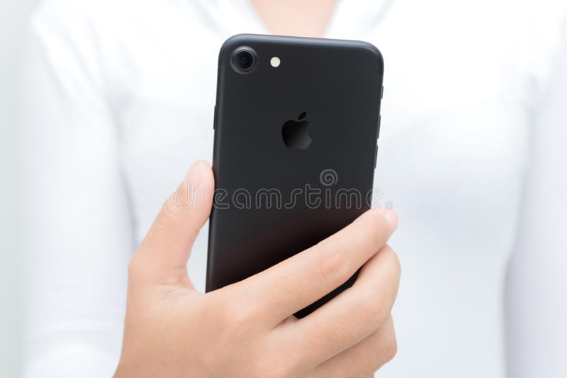 Close-up woman hand hold iphone 7 showing backside stock photos