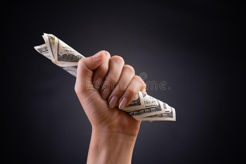 Close up woman hand holding American dollar in the dark background. Business finances, savings and bankruptcy concept.  stock images