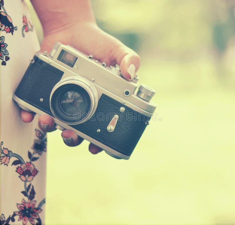 Close up of woman hand holding retro camera royalty free stock photo