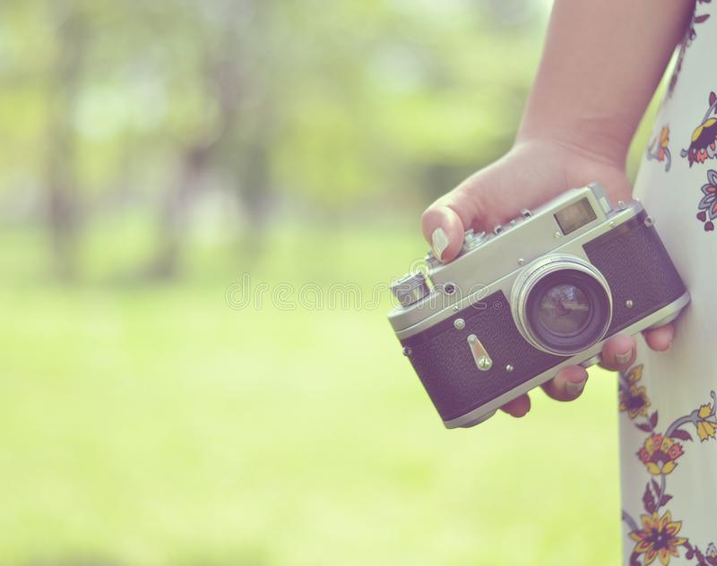 Close up of woman hand holding retro camera royalty free stock photography