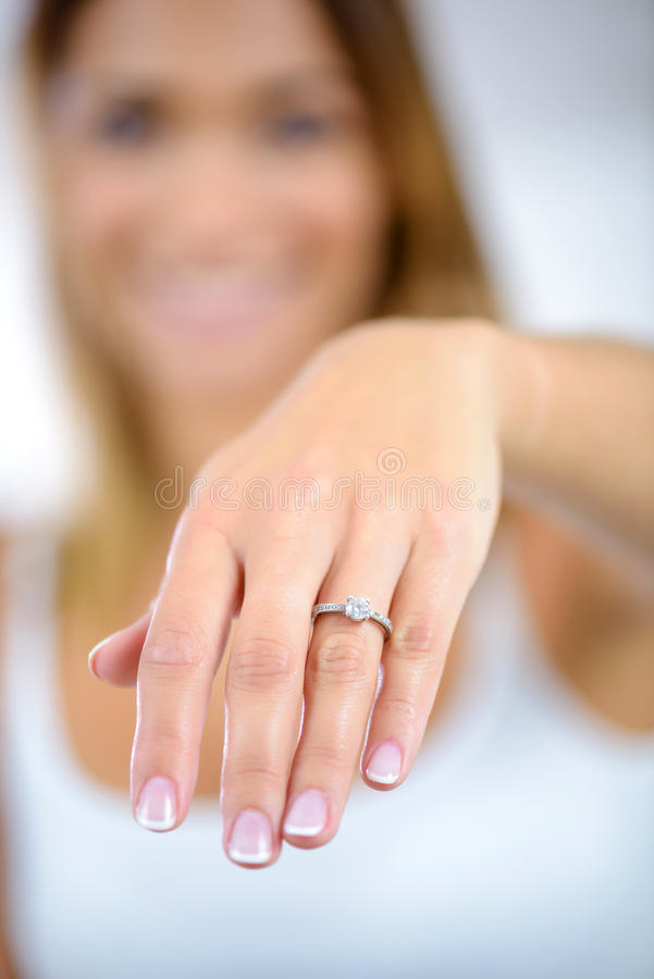 Close up woman hand showing beautiful ring with diamond royalty free stock photography
