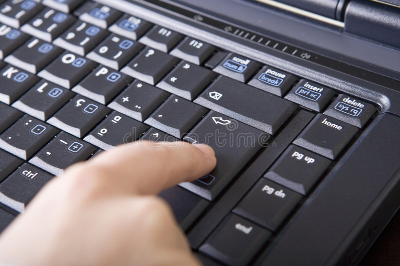 Close up Woman hand touching laptop computer keybo stock photos