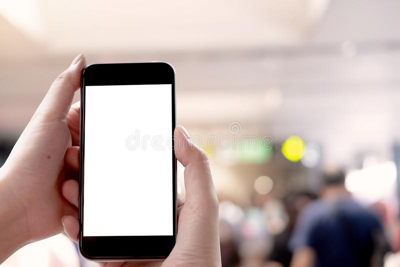 Close up Woman hand Using a Smart Phone with blank screen at maket stock image