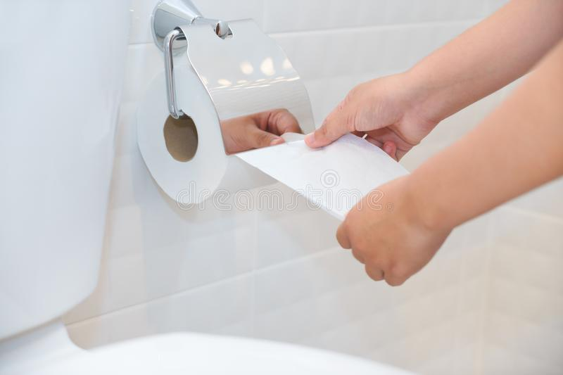 Close up of A woman hand using toilet paper in white and clean t stock images