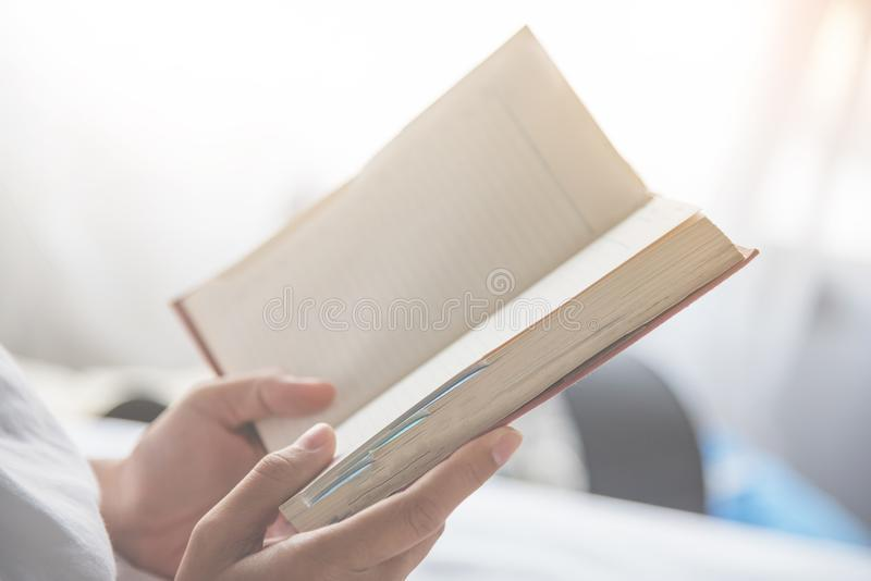 Close up woman hands holding a book royalty free stock photography