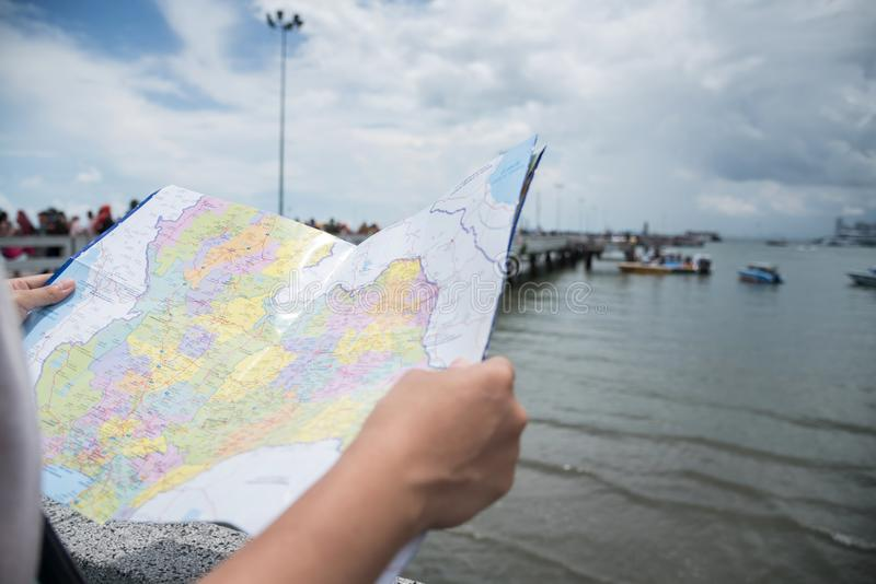Close up woman hands holding the map at the port stock photos