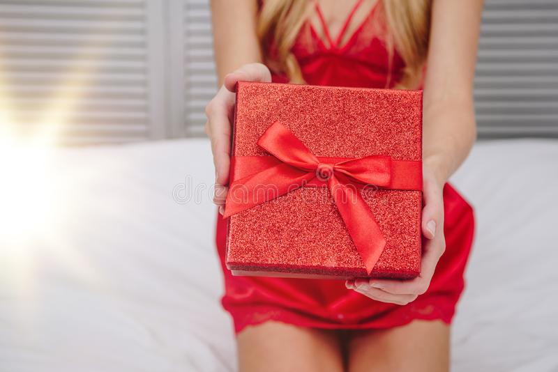 Hands holding red gift box. Close up of woman hands holding red gift box, valentines day concept royalty free stock photo