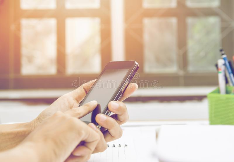 Close up of  woman hands holding touching mobile phone with blank copy space for your text message in home royalty free stock photography