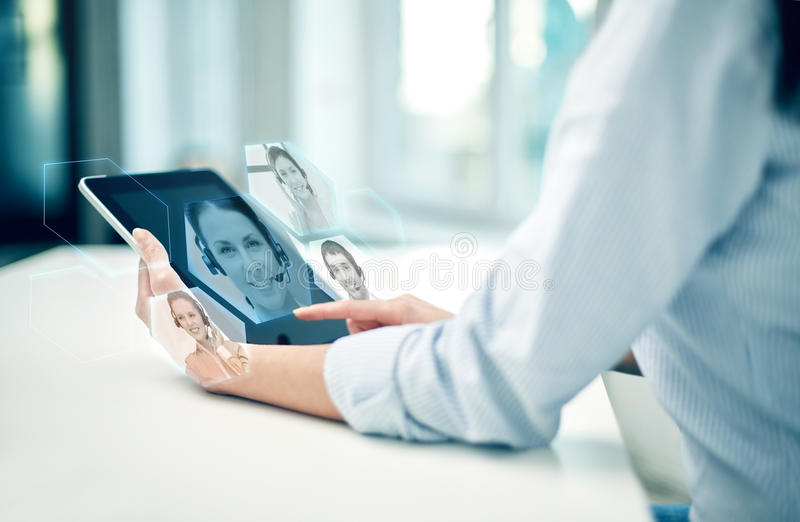Close up of woman hands with tablet pc at office. Business, technology, communication and people concept - close up of women holding tablet pc computer and royalty free stock image