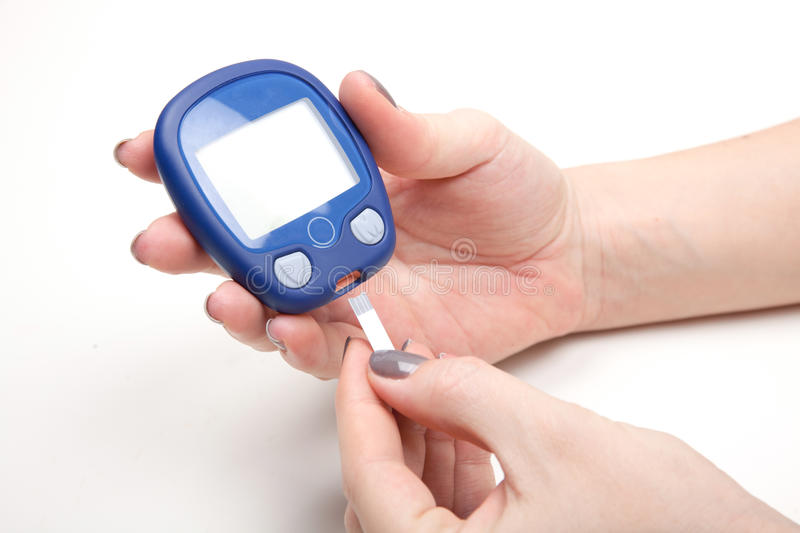 Close-up Of Woman Hands Testing High Blood Sugar With Glucometer stock photo