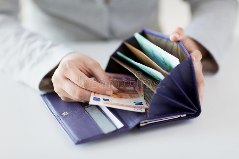 Close up of woman hands with wallet and euro money stock image