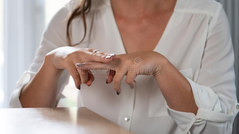 Close Up Of Woman Having Conversation At Home Using Sign Language. Woman Having Conversation At Home Using Sign Language stock photography