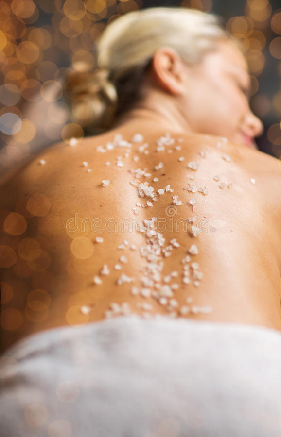 Close up of woman having salt massage in spa royalty free stock image