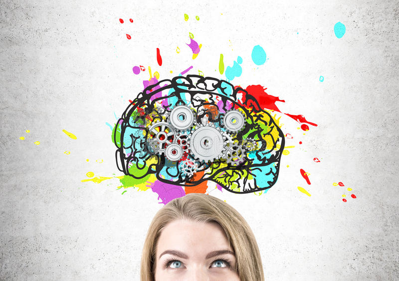 Close up of woman head with brain and cogs. Close up of a blond woman head with gray eyes. She is standing near a concrete wall with a colorful and bright brain stock photography