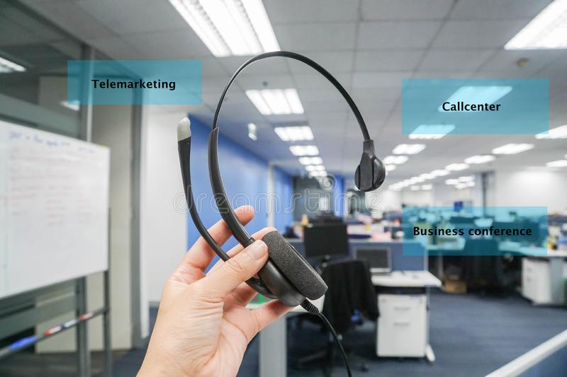 Woman hold headset for callcenter, telemarketing and business conference in office. Close up woman hold headset for callcenter, telemarketing and business royalty free stock photos