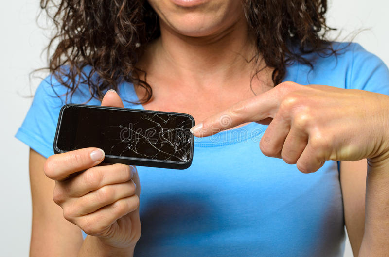 Close up of woman holding broken mobile phone stock photo