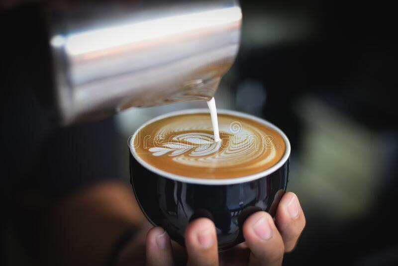 Close-up of Woman Holding Coffee Cup at Cafe royalty free stock photography