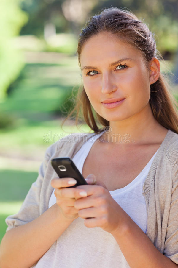 Download Close Up Of Woman Holding Her Cellphone Stock Photo - Image: 25333720
