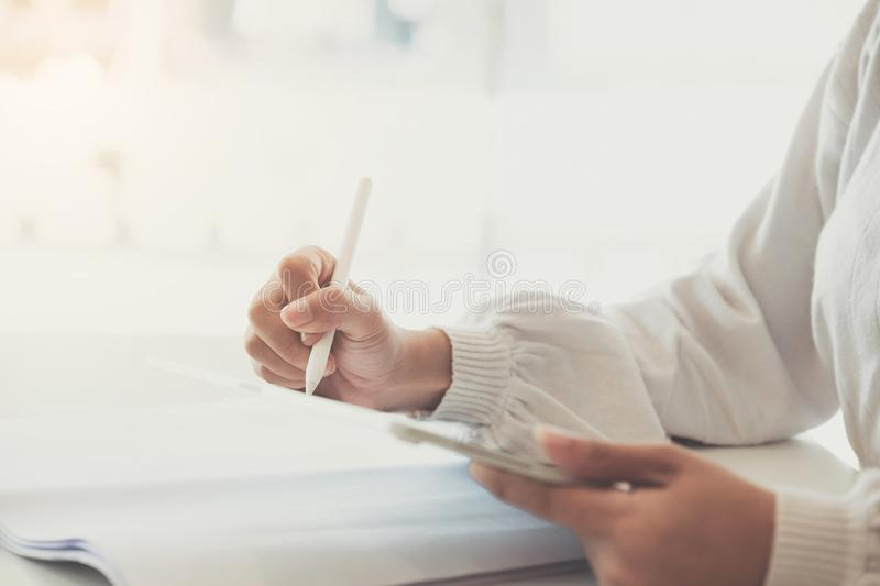 Close up of Woman holding new version digital tablet device in hands with smart pencil.  stock photos