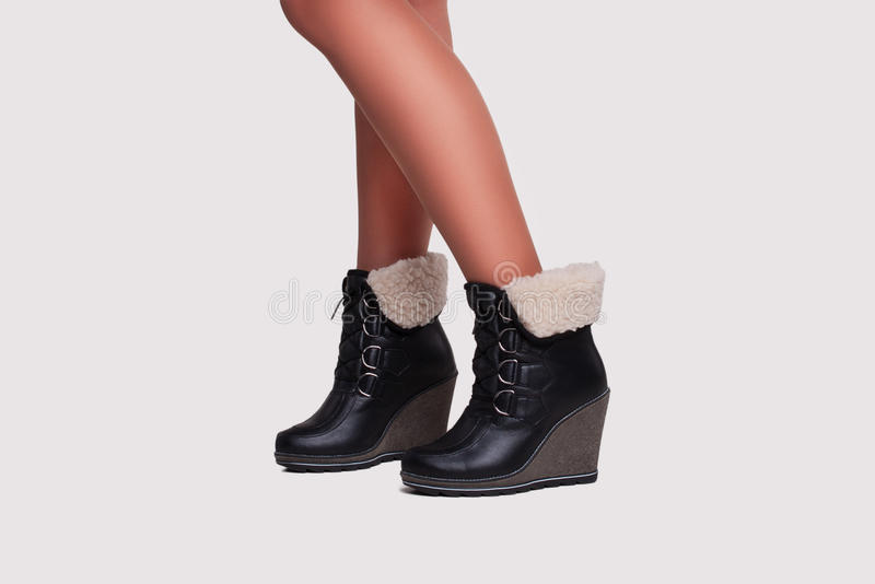 Close-up of woman legs in stockings and boots royalty free stock photography