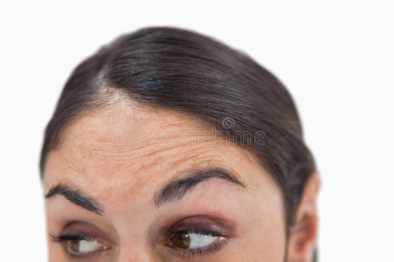 Close up of a woman looking under her