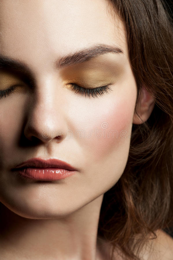 Close-up of woman with make-up. Close-up portrait of young beautiful woman with closed eyes with stylish make-up royalty free stock photography